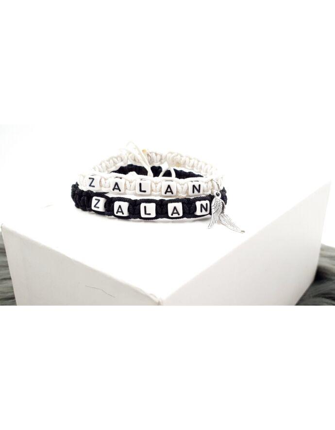 Fehér&Fekete páros karkötő angyalszárny medálokkal